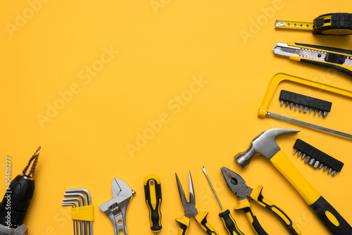 Obraz na plátně Construction tools on the yellow flat lay background with copy space