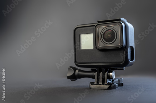 black action camera on dark background #404621086