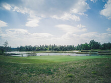 View Of Golf Course With Fairway Field . Golf Course With A Rich Green Turf Beautiful Scenery.