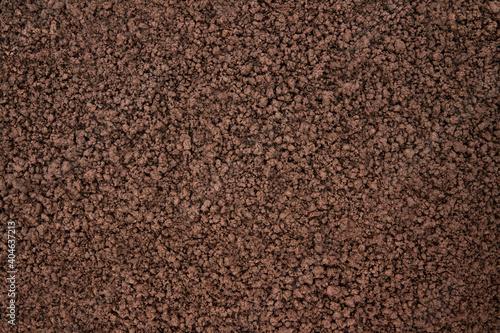 Fototapeta brown soil texture, top view. organic ground background