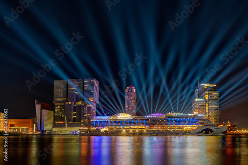 Obraz Illuminated Buildings At Waterfront In City During Night - fototapety do salonu