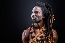 Shaman Tribal Ritual Man Isolated In Studio, Exotic Aborigen With Ethnic Make-up On Face, Shirtless African Male With Dreadlocks