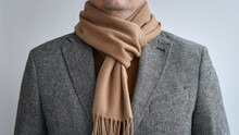 Detail Of Mens Outfit, Fashionable Grey Tweed Blazer Combined With Light Beige Scarf.  Selective Focus.