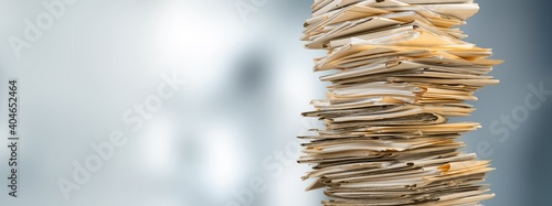Stack file folders with documents on the desk
