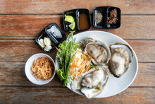 Oysters,Spicy Oyster Salad,Yum, Oyster And Side Dishes In Thai Style With Spicy Dipping Sauce.