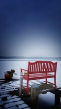 Red Bench On Pier Over Lake During Winter
