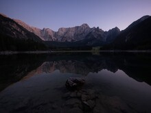 Alpine Mountain Lake Landscape Panorama Reflection At Laghi Di Fusine Weissenfelser See In Tarvisio Dolomites Alps Italy