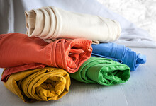 Close-up Of Colorful Pants Rolled On Table