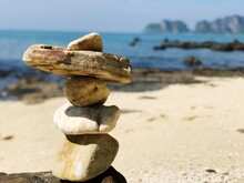 Stack Of Stones At Beach During Sunny Day