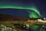 Fototapeta Na ścianę - Scenic View Of Illuminated Building By Mountain Against Sky At Night