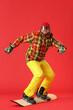 Leinwandbild Motiv Male snowboarder on color background