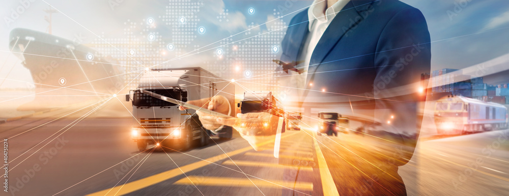 Fototapeta Businessman using tablet on logistic network distribution and smart transportation and networking intelligent logistics of truck and train container cargo ship, Logistic import export and industry.