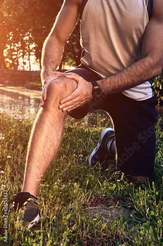Fototapeta Sports jogging running injury in the park, young man having knee pain problem. obraz