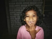 Close-up Portrait Of Innocent Girl