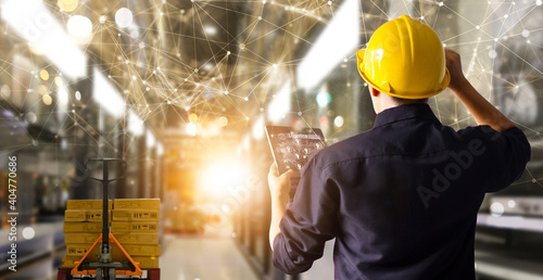 Canvastavla Factory engineer hold tablet manage inventory control and deliverly smart transportation through intelligent warehouse management system