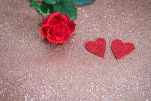 Two Red Glitter Hearts And Red Rose On Shiny Background