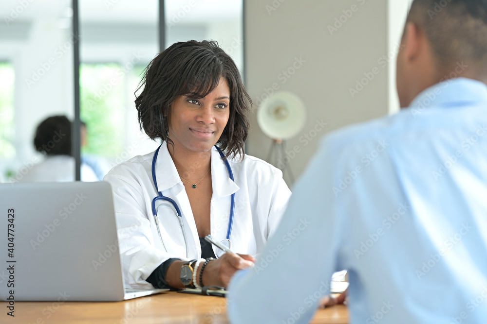 Fototapeta Portrait of young therapist meeting with patient in medical office