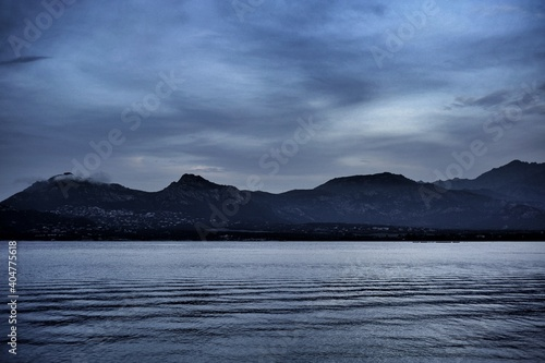 Obraz Scenic View Of Lake By Mountains Against Sky - fototapety do salonu