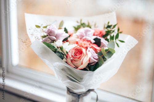 Valokuvatapetti A large beautiful bouquet of mix flowers on a light background