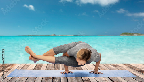 Obraz na plátně fitness, sport, people and healthy lifestyle concept - woman making yoga in hand