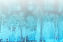 Frosty Patterns On Glass. Beautiful Winter Background. Christmas And New Year.