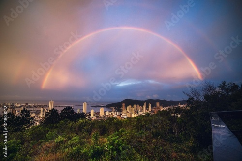 Obraz Rainbow Over Buildings In City Against Sky - fototapety do salonu