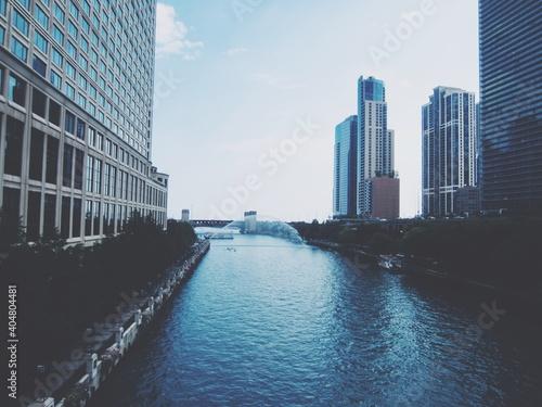 Stampa su Tela River Amidst Buildings In City Against Sky