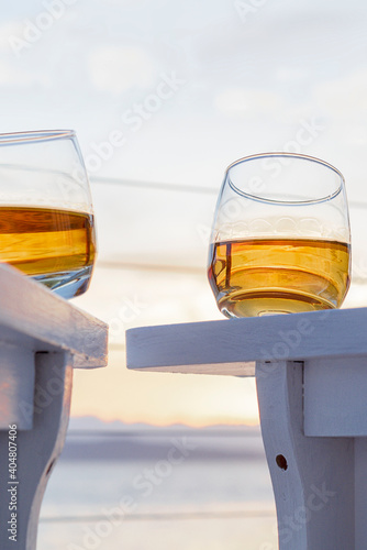 Obraz Low Angle View Of Whiskey On Table Against Sky During Sunset - fototapety do salonu