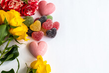 Top View Of Heart Shaped Candies And Flowers, Flat Lay Of Berry Sweets Or Marmalade And Roses For Valentine's Day, Wedding Or Anniversary; Romantic Card With Copy Space