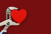 . Wrench With Hearts Isolated On Background. The Concept Of Your Favorite Profession And Valentine's Day.