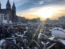 Bicycles In Parking Lot At City During Sunset