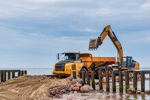 Industrial Truck Loader Excavator Moving Sand And Unloading It Into A Dumper Truck
