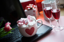 Large Mug Hot Chocolate With Marshmallows And Two Glasses Red Wine On Black Laptop Keyboard