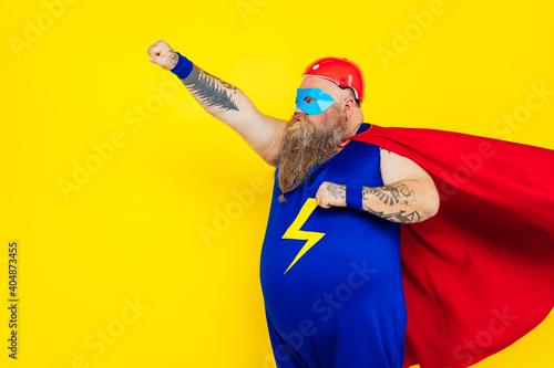 Funny man wearing a superhero costume Fotobehang