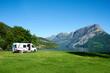 canvas print picture - Wohnmobil auf einem sehr schönen Campingplatz mit Bergen in Hintergrund und See