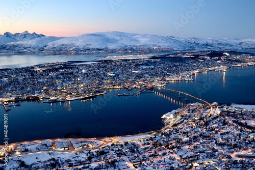 Aerial View Of City By Snowcapped Mountains Against Sky