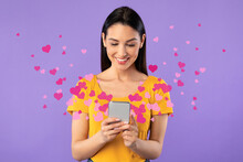 Woman Sending Love Message On Smartphone, Hearts Flying Away
