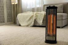 Modern Electric Halogen Heater On Floor In Living Room Interior