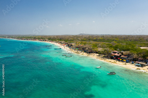Fotografie, Tablou Beautiful tropical sandy exotic emerald paradise beach with sunbeds and sun umbrellas aerial view