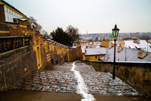 The Roofs Of Prague In The Snow