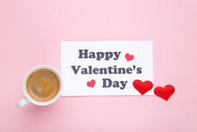 Cup Of Coffee And Paper With Text Happy Valentines Day On Pink Background
