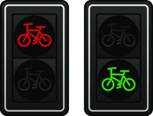 Two Sets Of LED Bicycle Lane Traffic Lights Showing Red Or Green Lights.
