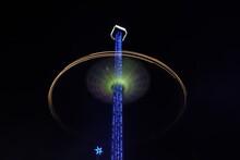 Low Angle View Of Illuminated Amusement Park Ride At Night