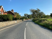 View Along, Ripley Road, With Stone Walls, Houses, And A Blue Sky In, Nidd, Knaresborough, UK