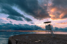 Lifeguard Observation Tower On The Beach At Sunset