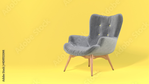 Comfortable fashionable gray designer armchair on yellow background. Trendy colors of the year 2021. Illuminating and Ultimate gray. Creative minimalistic layout with a single piece of furniture © olgaarkhipenko