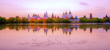 Sunset Vibrant Panoramic View Of Izmailovo Kremlin And Its Reflection In Steel Water
