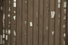 Wooden Wall Or Fence With Poster Remnants And Vertical Planks In A Full Frame View. This Is A Lighter Version, A Darker Version Is Also Available In The Portfolio