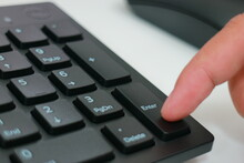 Cropped Finger Pressing Computer Keyboard