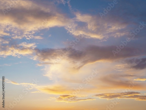 Fototapety, obrazy: Clouds illuminated by sunset sunlight in the blue sky. Background texture. Fullscreen photo